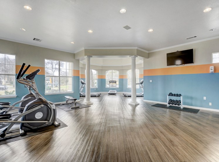 24 hour fitness center with cardio equipment and weights