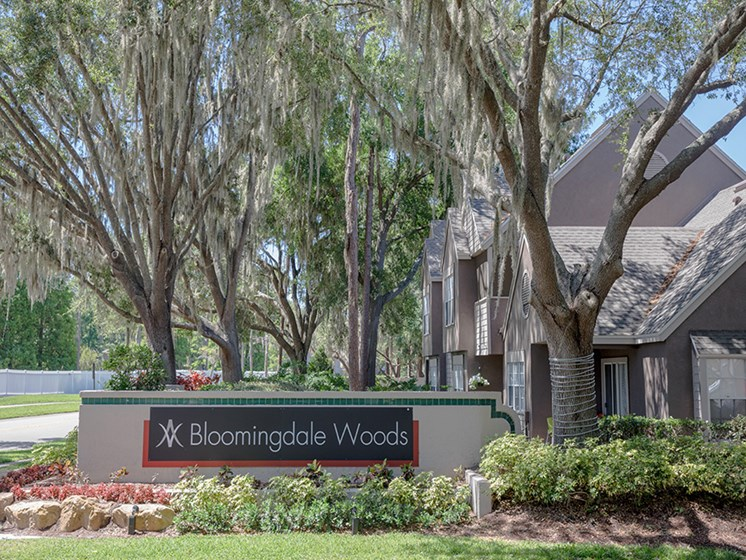 Bloomingdale Woods Apartments Valrico Florida Welcome Sign with Trees and Landscaping Bed