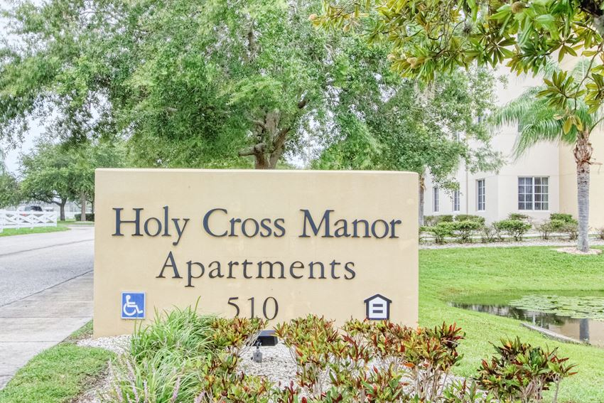 Monument sign at entrance to Holy Cross Manor I in Palmetto, FL