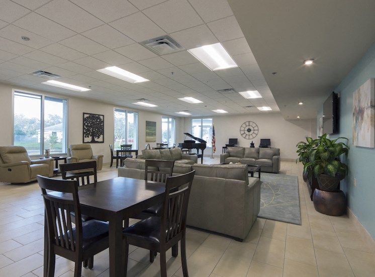Mount Carmel Gardens senior apartments in jacksonville, florida community room with grand piano