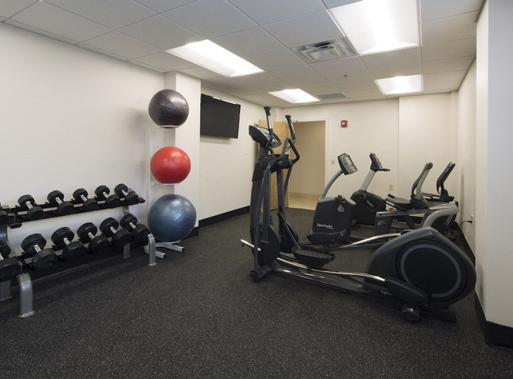 Mount Carmel Gardens senior apartments in jacksonville, florida fitness center with cardio and weight equipment