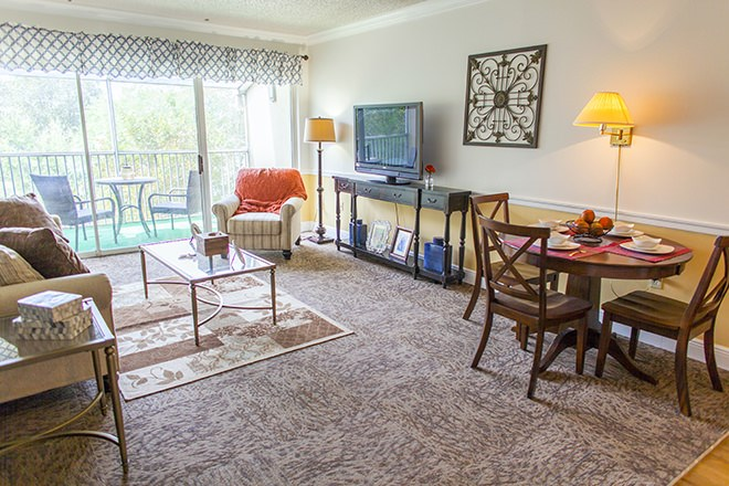 Well Appointed Living Room With Screened Balcony at Pacifica Senior Living Sunrise, FL, 33351
