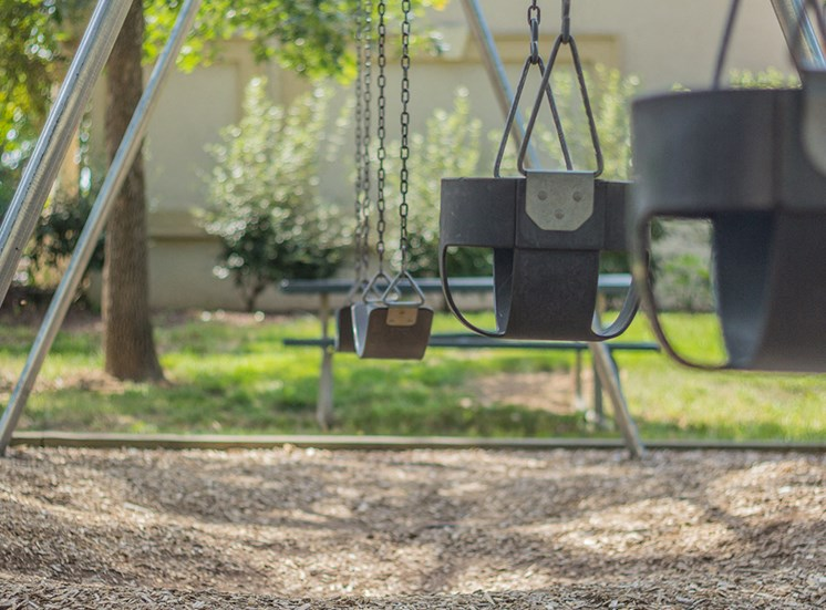 swings at playground for apartment complex