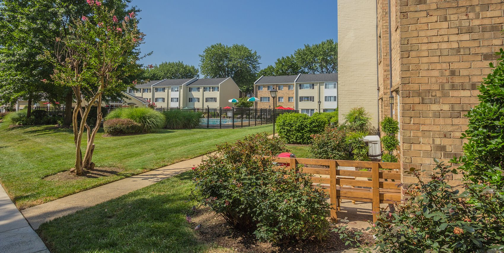 view of walkway on the premise with nice landscaping at apartment complex