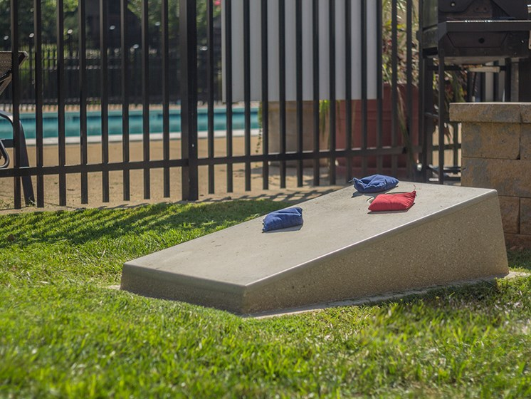 cornhole area next to swimming pool