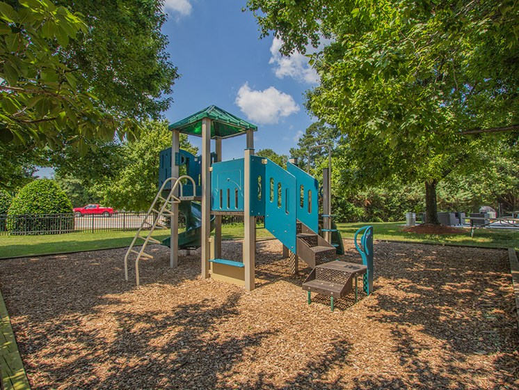 playground structure with play area for apartment complex