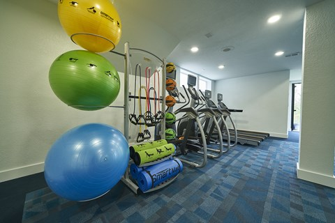 modern interior of apartment building with workout equipment