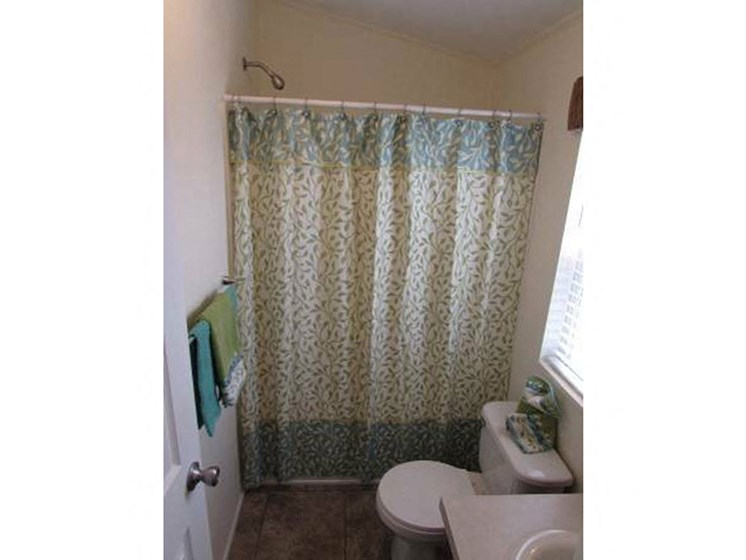 Bathroom Shower With Curtain at Heritage Oaks Rental Homes in Lincoln, NE