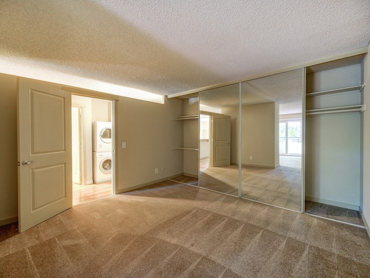 Luxury Apartment Community Bedroom with View of In Unit Washer Dryer