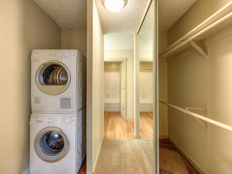 In Unit Washer and Dryer with Clothes Rod, Carpet and Hardwood Inspired Floor