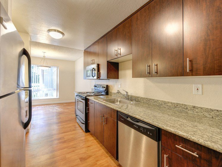 Luxury Apartment Community Kitchen with Granite Counters and Modern Wood Cabinets