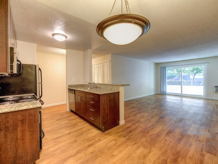 Luxury Apartment Community Kitchen with View of Living Room and Private Patio