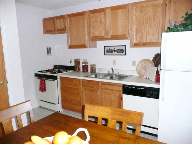 Well Equipped Kitchen And Dining at Emerald Court, Iowa City, IA