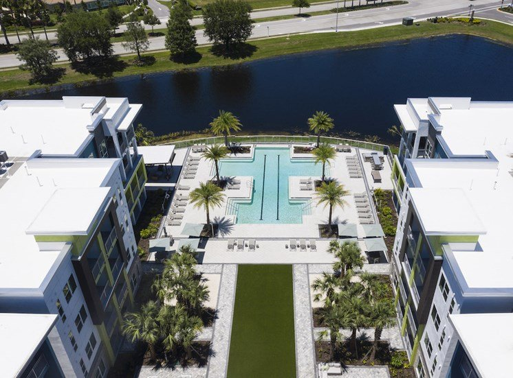 Residences at The Green pool, green, and buildings seen from the air