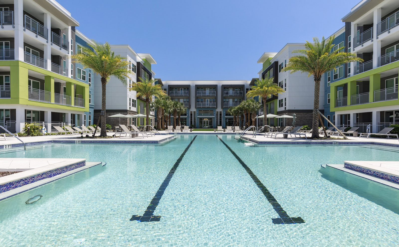 Large swimming pool and sundeck at Residences at The Green