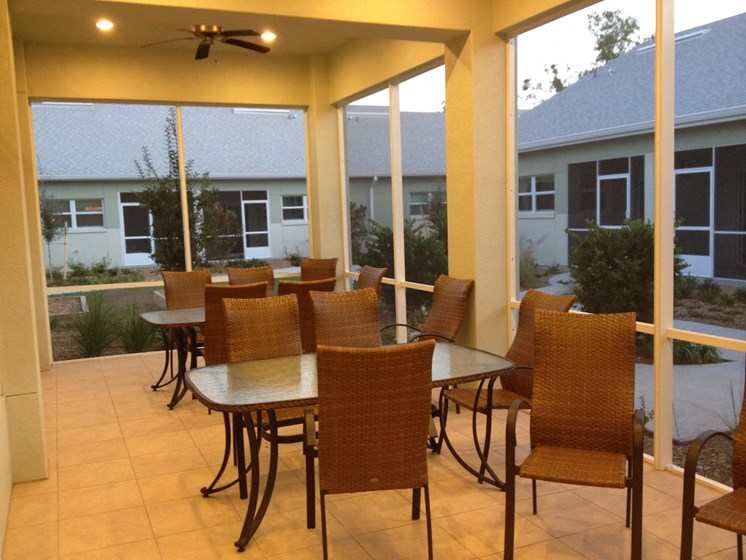 St. Anthony Garden Court apartments in St. Cloud, FL breezeway with seating