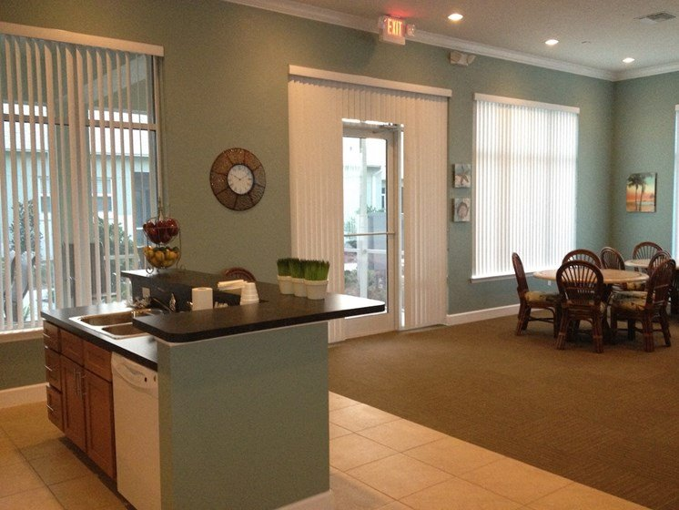 St. Anthony Garden Court apartments in St. Cloud, FL beautiful community room with seating