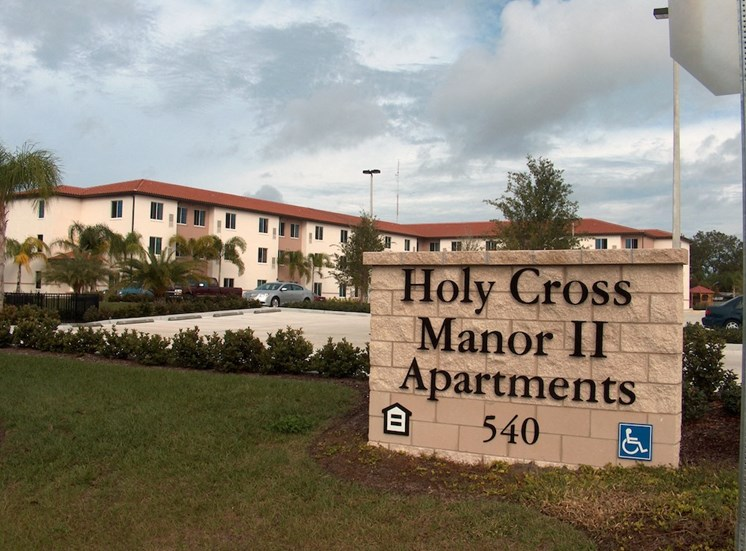 Holy Cross Manor I and II senior apartments in Palmetto, FL signage