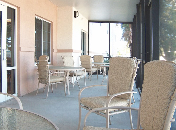 Holy Cross Manor I and II senior apartments in Palmetto, FL relaxing screened patio seating