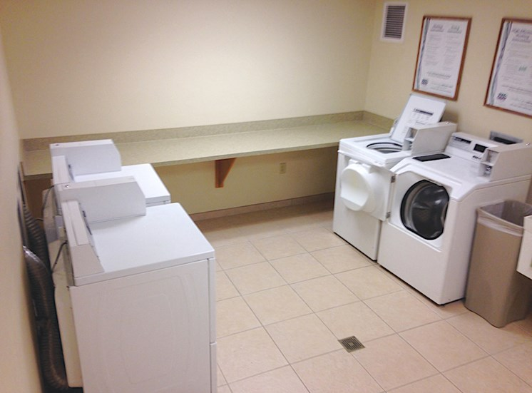 Holy Cross Manor I and II senior apartments in Palmetto, FL laundry center with washers and dryers