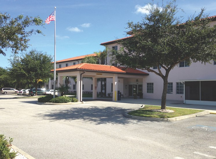Holy Cross Manor I and II senior apartments in Palmetto, FL covered drive up entrance