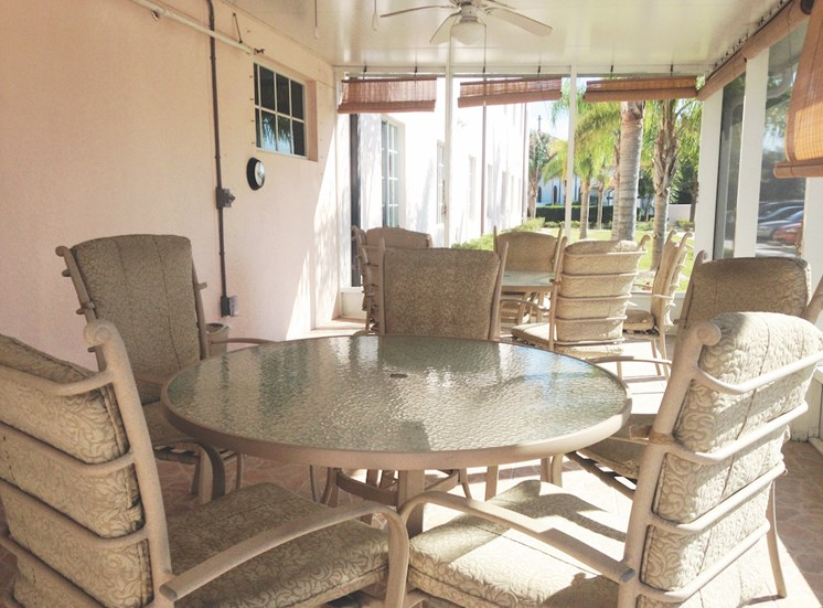 Holy Cross Manor I and II senior apartments in Palmetto, FL patio with tables and seating