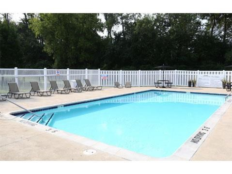 outdoor pool and pool chairs_Lakestone Apartments, Ann Arbor, MI