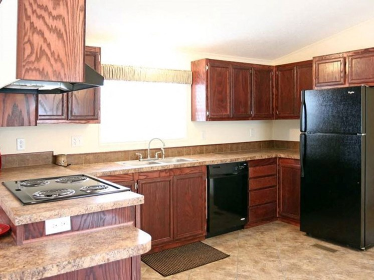 Fully Equipped Kitchen at Maple Grove Rental Home Community in Lincoln, NE