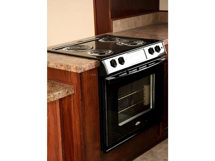 Conventional Oven in Kitchen at Maple Grove Rental Home Community in Lincoln, NE