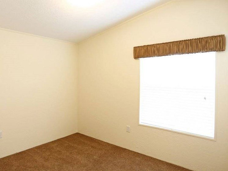 Bedroom With Large Window at Maple Grove Rental Home Community in Lincoln, NE