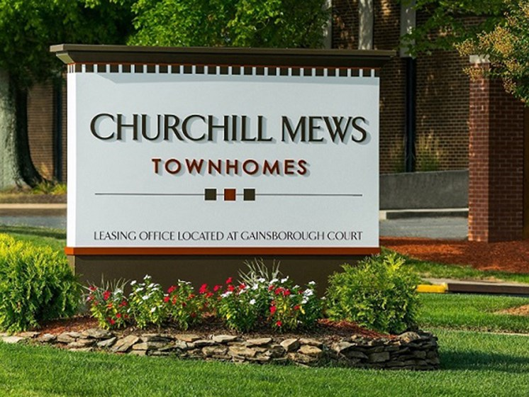 churchill mews sign near entrance of apartments