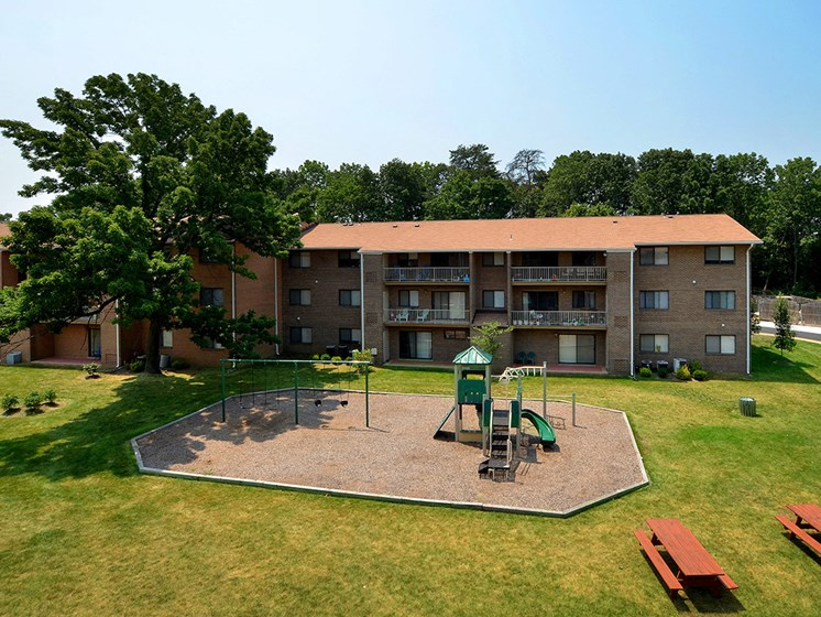 far away view of apartment complex with playground