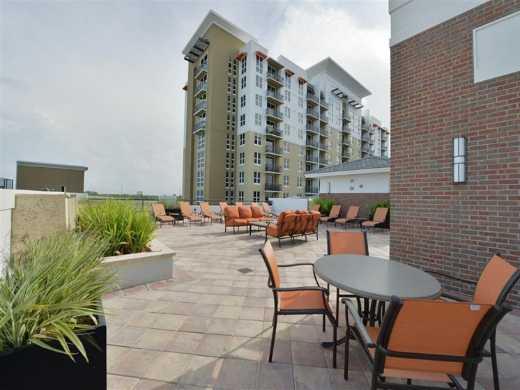 Exterior of apartment building with outdoor seating area