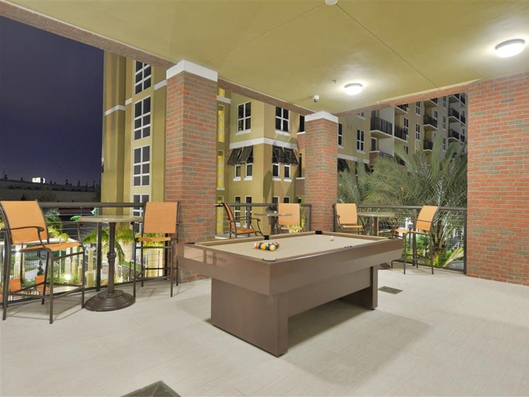 Clubhouse with billiards table and outdoor lighting at apartments in plantation florida
