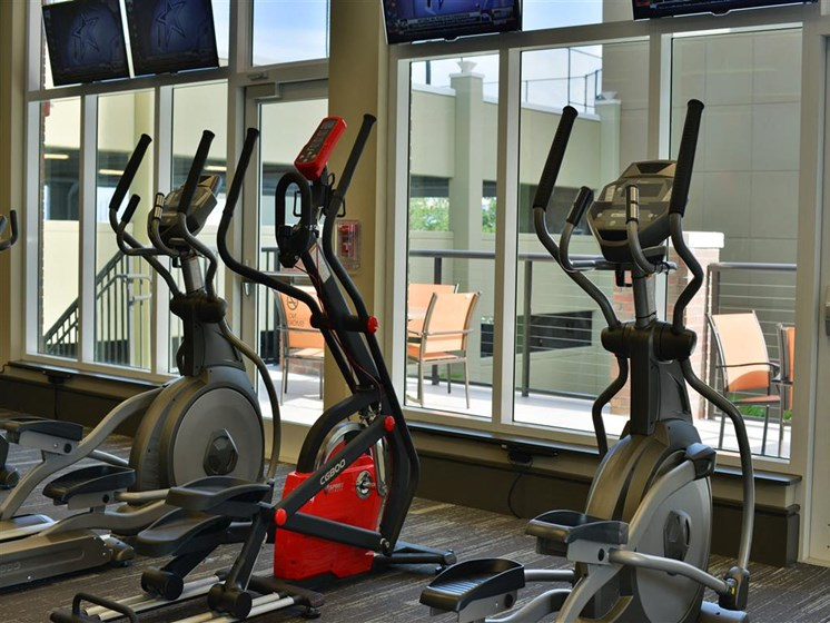 Gym with elliptical machines and windows