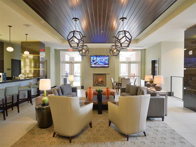 Clubhouse with contemporary seating and modern light fixtures in plantation apartments
