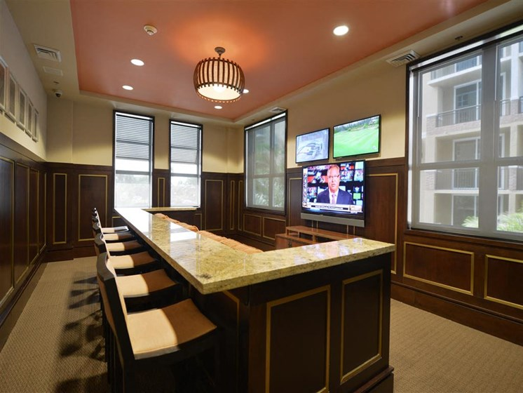 Clubhouse with community bar and tvs for residents