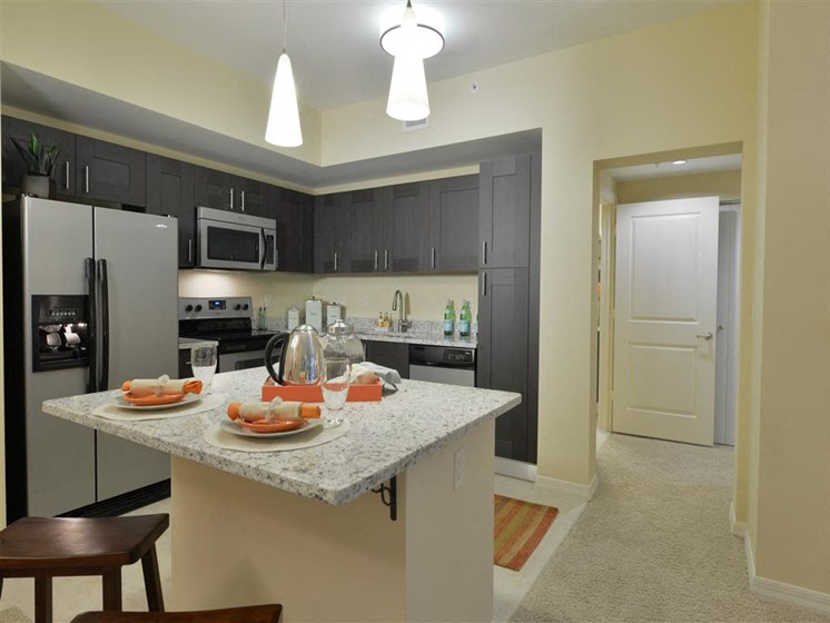 Kitchen with granite counter island area
