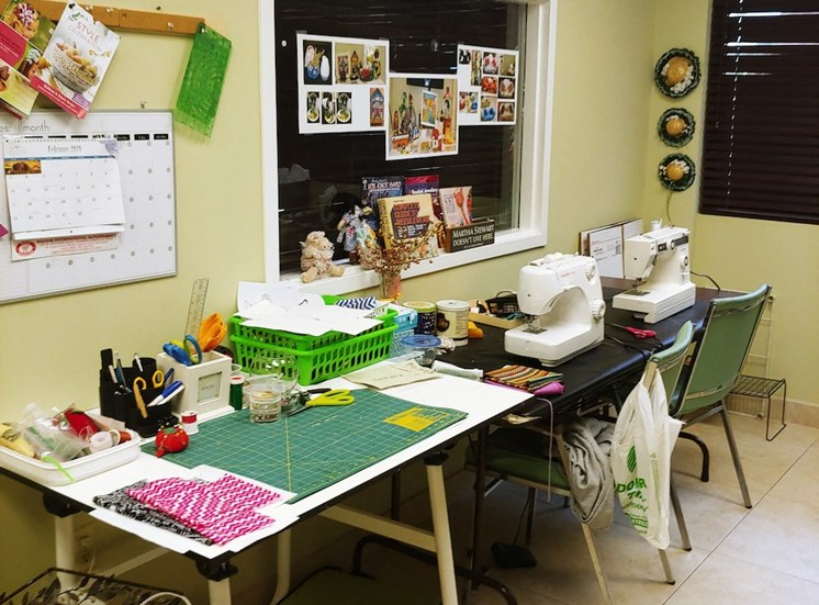 craft room with sewing machines and more at B'nai B'rith I, II, & III apartments in deerfield beach