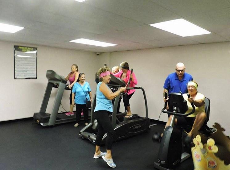 Residents enjoying the gym at B'nai B'rith I, II, III deerfield apartments in deerfield beach, FL