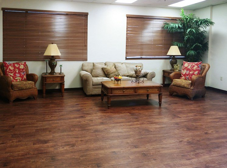 nice sitting area with couch, chairs, and lamps at B'nai B'rith I, II, & III apartments in deerfield beach