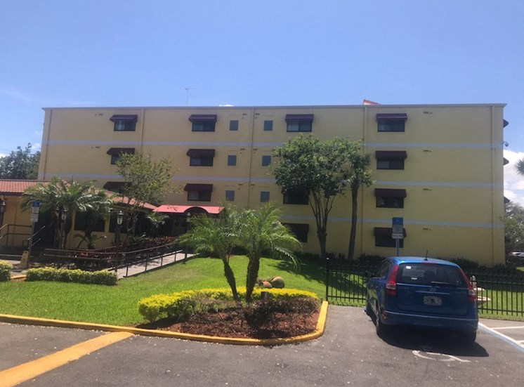 well-kept grounds and parking at Casa San Pablo Senior apartments in Daytona Beach, FL