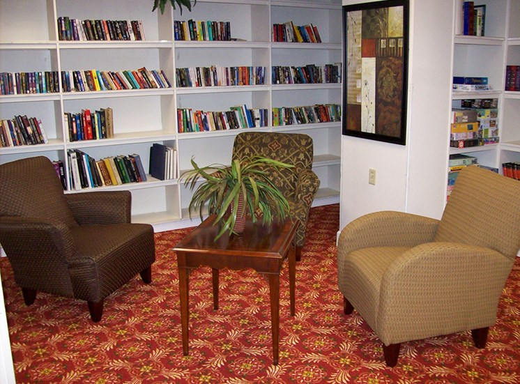 fully-stocked library with comfortable arm chairs