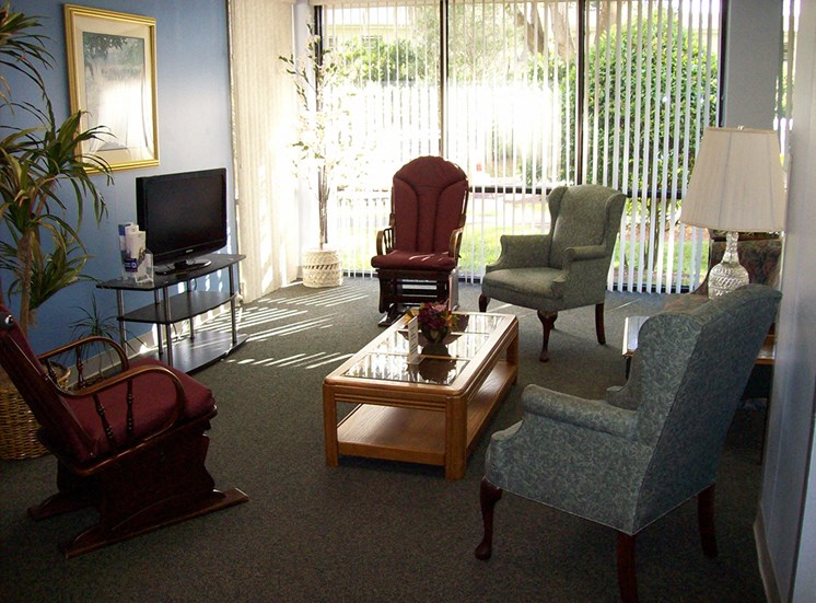 seating area with television and large windows