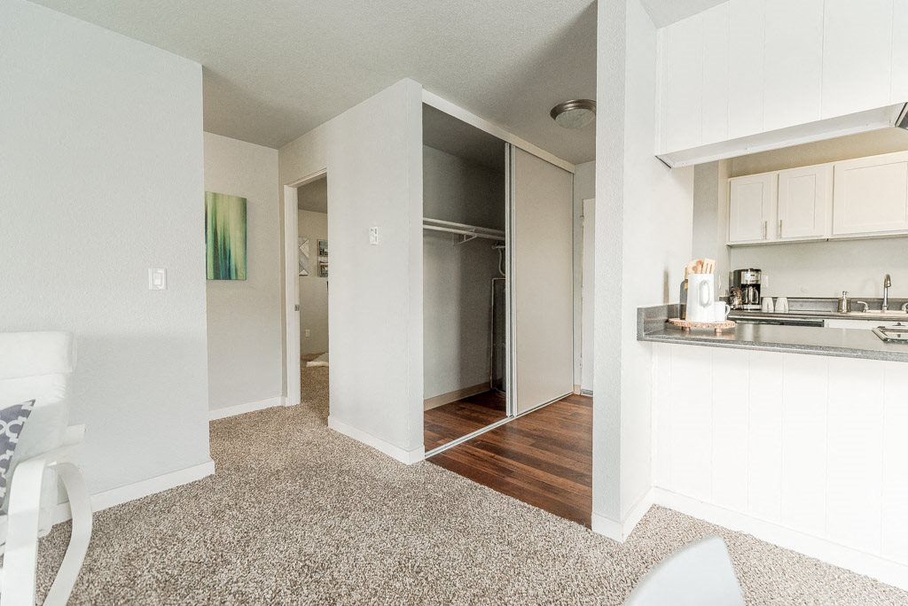 Renton Apartments - The Aviator Apartments - Hallway, Closet, Entryway, Living Room, Bedroom, and Kitchen