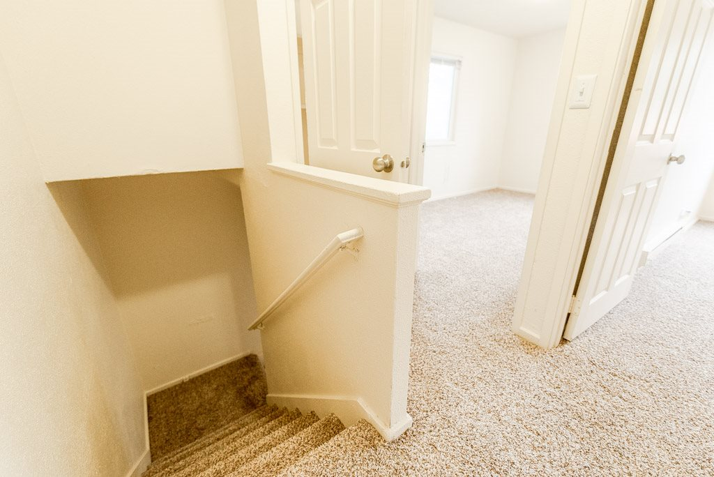 Lakewood Apartments - Pacific Walk Apartments - Top Floor Landing, Stairs, and Bedrooms