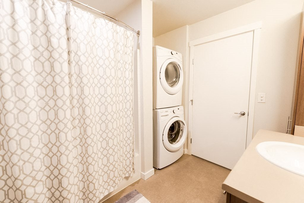 Kent Apartments - The Platform Apartments - Laundry Bathroom