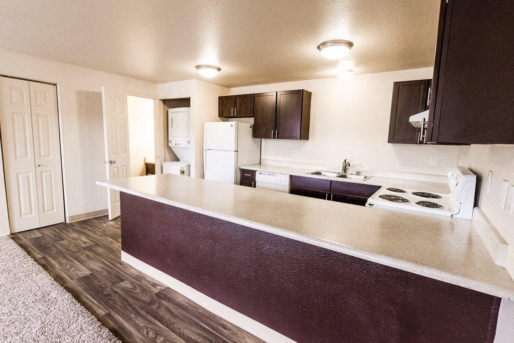 Lakewood Apartments - Southern Pines Apartments - Kitchen, Living Room, Laundry, and Half-Bath