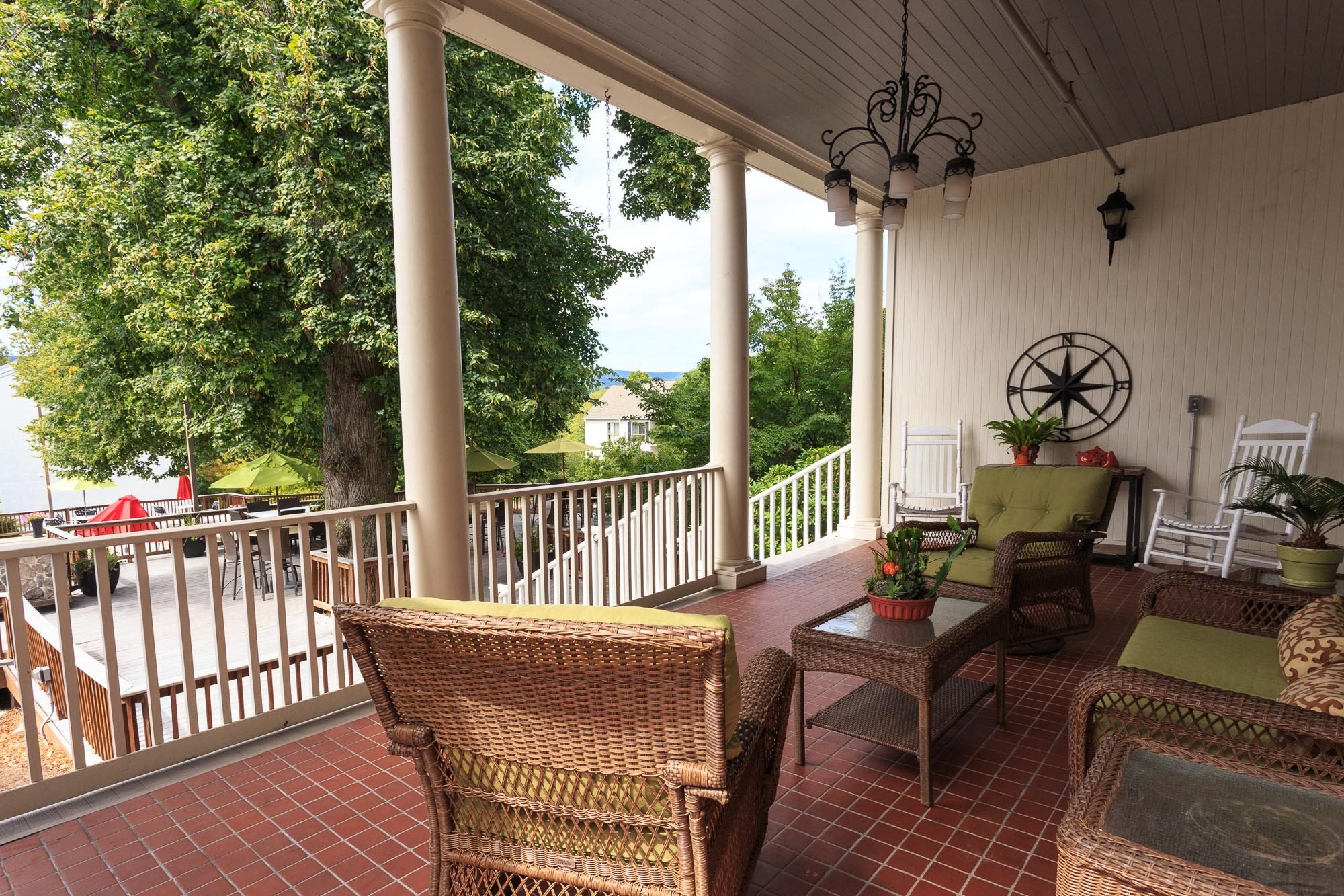 Veranda with Wi-Fi and Rocking Chairs at The Residences at the Manor Apartments, Maryland, 21702