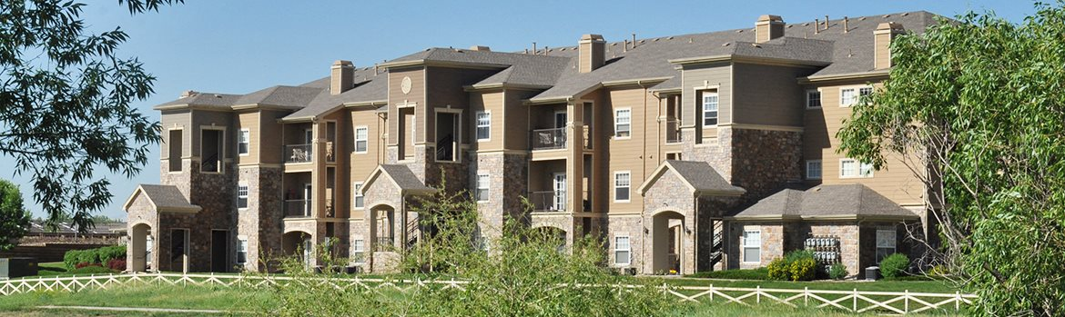 Banner Image of the exterior of Courtney Downs Apartment Homes 80112